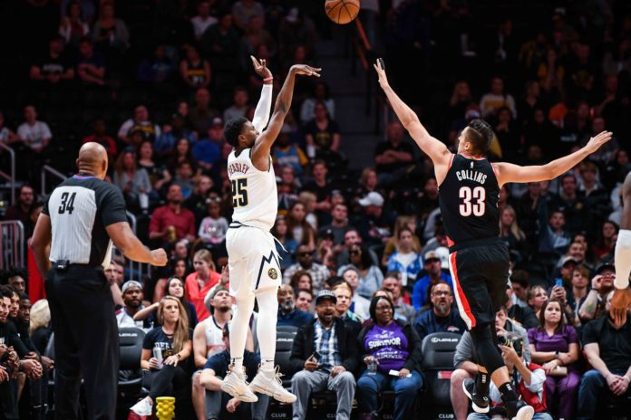 Denver Nuggets guard Malik Beasley (25) takes a shot over Portland Trail Blazers forward Zach Collins (33) during the first half at Pepsi Center.