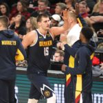 Denver Nuggets center Nikola Jokic (15) high-fives teammates after scoring against the Portland Trail Blazers during a timeout in the second half at Moda Center.