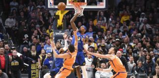 Denver Nuggets forward Torrey Craig (3) blocks a shot by Phoenix Suns guard Devin Booker (1) to secure the win in overtime at Pepsi Center.
