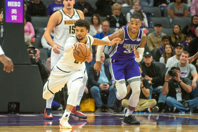 Denver Nuggets guard Jamal Murray (27) gains possession of the ball during the fourth quarter against the Sacramento Kings at Golden 1 Center.