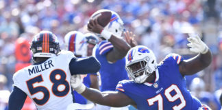 Buffalo Bills offensive tackle Jordan Mills (79) tries to keep Denver Broncos outside linebacker Von Miller (58) off of his quarterback on a pass rush during the fourth quarter of a game at New Era Field.