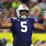 Auburn Tigers defensive tackle Derrick Brown (5) raises his arms during the game against the Oregon Ducks at AT&T Stadium.