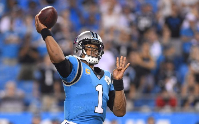 Cam Newton considering surgery for injured foot