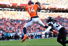 Denver Broncos wide receiver Courtland Sutton (14) pulls in a touchdown past Jacksonville Jaguars cornerback Tre Herndon (37) in the fourth quarter at Empower Field at Mile High.