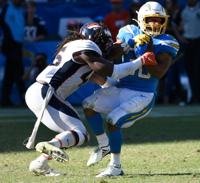 Denver Broncos linebacker A.J. Johnson (45) stops Los Angeles Chargers running back Austin Ekeler (30) after a short gain in the 4th quarter at Dignity Health Sports Park.