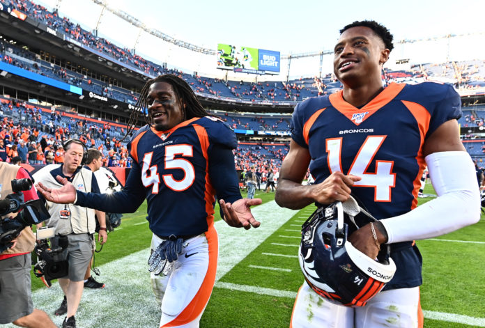 Denver Broncos linebacker Alexander Johnson (45) and wide receiver Courtland Sutton (14) following the win over the Tennessee Titans the at Empower Field at Mile High.