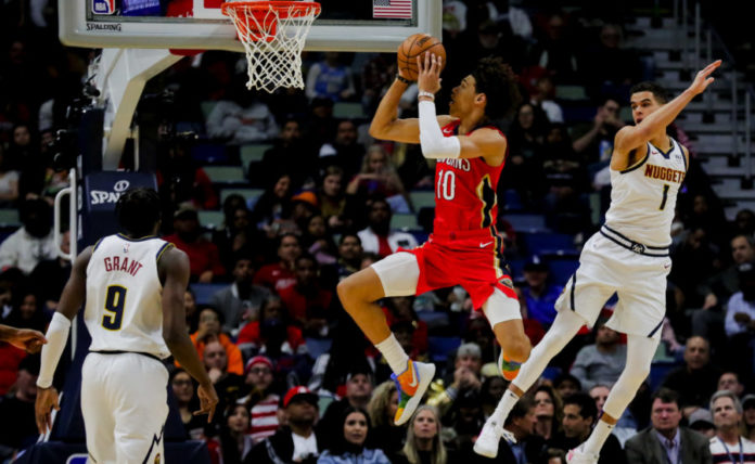 New Orleans Pelicans center Jaxson Hayes (10) shoots over Denver Nuggets forward Michael Porter Jr. (1) during the first quarter at the Smoothie King Center