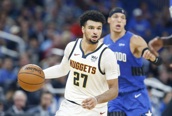 Denver Nuggets guard Jamal Murray (27) brings the ball down court past Orlando Magic forward Aaron Gordon (00) during the second quarter at Amway Center.