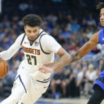 Denver Nuggets guard Jamal Murray (27) drives around Orlando Magic guard Markelle Fultz (20) during the second half at Amway Center
