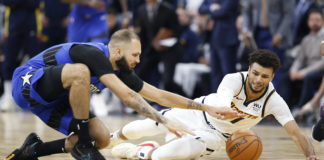 Orlando Magic guard Evan Fournier (10) goes for the ball against Denver Nuggets guard Jamal Murray (27) for a loose ball during the second half at Amway Center.