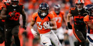 Denver Broncos running back Phillip Lindsay (30) runs for a touchdown in the third quarter against the Cleveland Browns at Empower Field at Mile High.