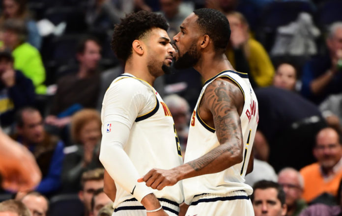 Denver Nuggets forward Will Barton (5) celebrates his basket with guard Jamal Murray (27) in the first quarter against the Miami Heat at the Pepsi Center.