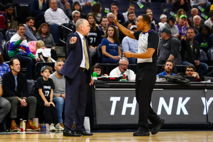 Denver Nuggets head coach Michael Malone argues with referee Rodney Mott (71) in the fourth quarter against the Minnesota Timberwolves at Target Center.