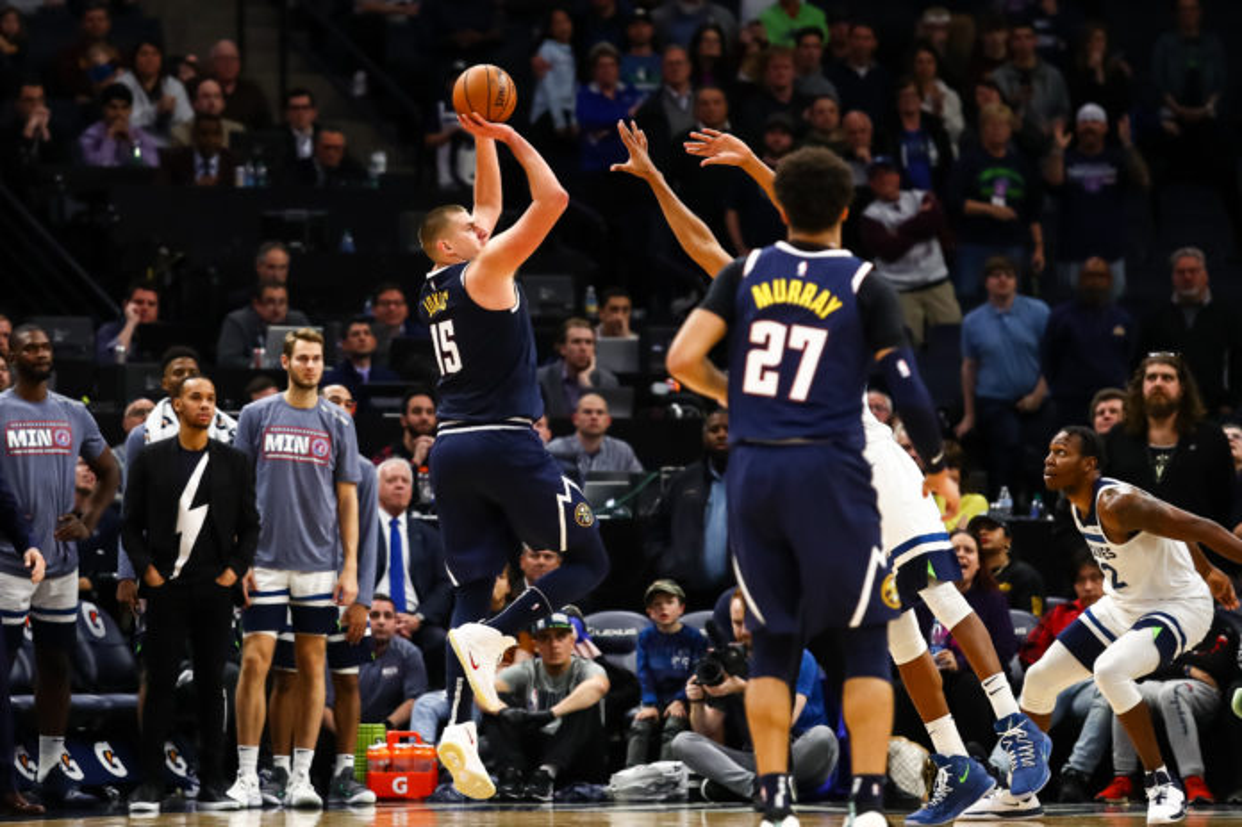Denver Nuggets center Nikola Jokic (15) shoots the ball against the Minnesota Timberwolves during overtime at Target Center.