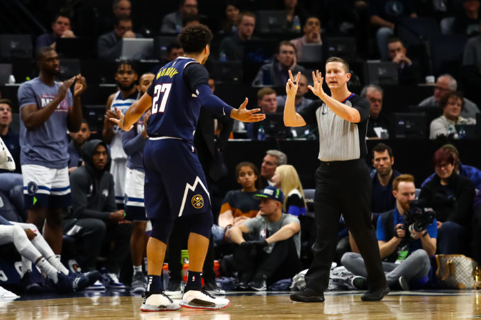 Denver Nuggets guard Jamal Murray (27) reacts after getting called for a foul in the fourth quarter against the Minnesota Timberwolves at Target Center.