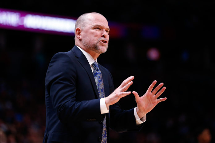 Denver Nuggets head coach Michael Malone gestures in the second quarter against the Atlanta Hawks at the Pepsi Center.