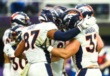 Denver Broncos tight end Noah Fant (87) celebrates with fullback Andy Janovich (32) after Janovich scored a touchdown in the first quarter against the Minnesota Vikings at U.S. Bank Stadium.