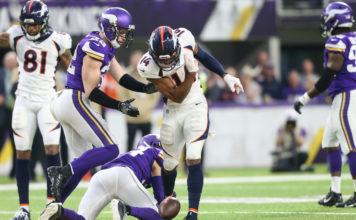 Denver Broncos wide receiver Courtland Sutton (14) celebrates after gaining a first down against the Minnesota Vikings during the third quarter at U.S. Bank Stadium
