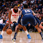 Houston Rockets guard James Harden (13) controls the ball as Denver Nuggets guard Gary Harris (14) guards in the third quarter at the Pepsi Center.