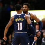 Denver Nuggets guard Malik Beasley (25) celebrates with guard Monte Morris (11) after a play in the fourth quarter against the Phoenix Suns at the Pepsi Center.