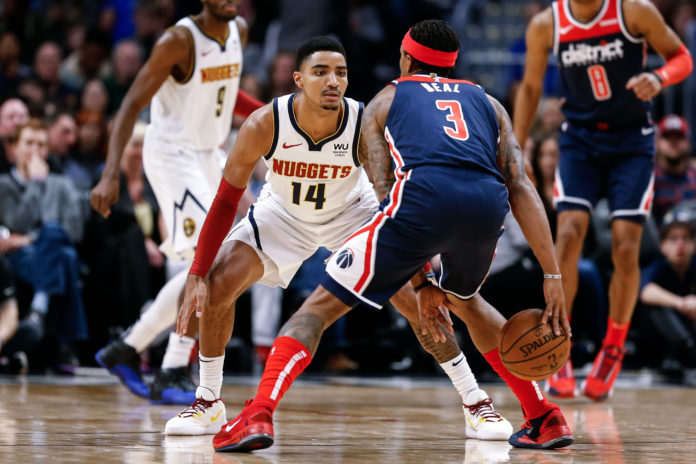 Washington Wizards guard Bradley Beal (3) controls the ball as Denver Nuggets guard Gary Harris (14) guards in the second quarter at the Pepsi Center.
