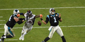 Denver Broncos wide receiver Demaryius Thomas (88) knocks the ball from Carolina Panthers quarterback Cam Newton's (1) hand for a fumble in Super Bowl 50 at Levi's Stadium.