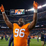 Defensive end Shelby Harris #96 of the Denver Broncos walks off the field celebrating after the Denver Broncos 24-17 win over the Pittsburgh Steelers at Broncos Stadium at Mile High on November 25, 2018 in Denver, Colorado.