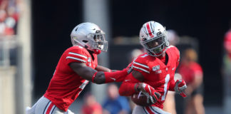 Ohio State Buckeyes cornerback Jeff Okudah (1) is congratulated by safety Jordan Fuller (4) following his interception during the first half against the Miami (Oh) Redhawks at Ohio Stadium.