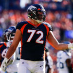 Denver Broncos offensive tackle Garett Bolles (72) reacts after receiving a penalty in the second quarter against the Tennessee Titans at Empower Field at Mile High.