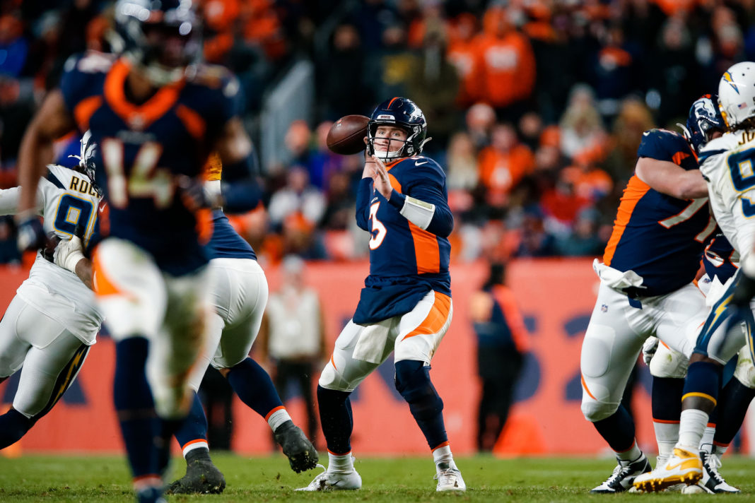 Denver Broncos quarterback Drew Lock (3) looks to pass in the fourth quarter against the Los Angeles Chargers at Empower Field at Mile High.