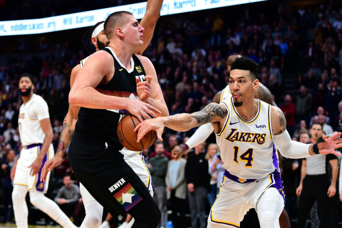 Los Angeles Lakers guard Danny Green (14) knocks the ball away from Denver Nuggets center Nikola Jokic (15) in the first quarter at the Pepsi Center.