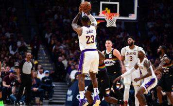 Los Angeles Lakers forward LeBron James (23) shoots a jump shot in the second quarter against the Denver Nuggets at the Pepsi Center.