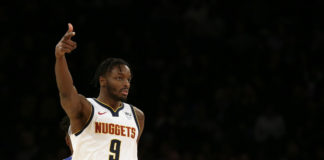 Denver Nuggets forward Jerami Grant (9) reacts after making a basket against the New York Knicks during the second half at Madison Square Garden.