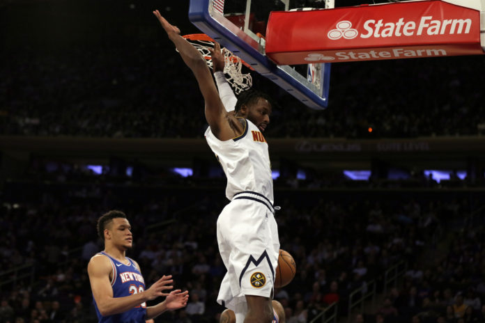 New York, NY, USA; Denver Nuggets guard Will Barton (5) slam dunks the ball over New York Knicks forward Kevin Knox II (20) during the first half at Madison Square Garden.