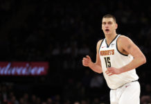 Denver Nuggets center Nikola Jokic (15) reacts after making a basket against the New York Knicks during the first half at Madison Square Garden.