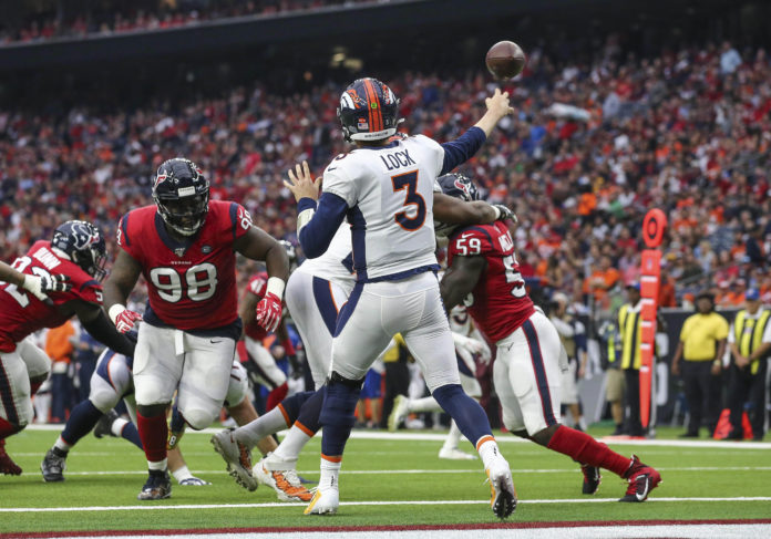 Denver Broncos quarterback Drew Lock (3) attempts a pass during the first quarter against the Houston Texans at NRG Stadium.