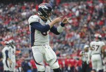 Denver Broncos quarterback Drew Lock (3) reacts after a touchdown by running back Phillip Lindsay (not pictured) during the third quarter against the Houston Texans at NRG Stadium.