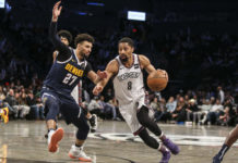 Brooklyn Nets guard Spencer Dinwiddie (8) looks to drive past Denver Nuggets guard Jamal Murray (27) in the fourth quarter at Barclays Center.