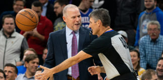 Denver Nuggets head coach Michael Malone reacts with referee Scott Foster (48) after being called for a technical foul during the second quarter against the Philadelphia 76ers at Wells Fargo Center.