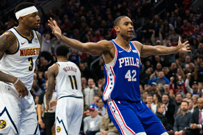 Philadelphia 76ers center Al Horford (42) reacts in front of Denver Nuggets forward Torrey Craig (3) after dunking the ball during the third quarter at Wells Fargo Center.