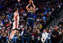 Denver Nuggets forward Michael Porter Jr. (1) attempts a basket over Portland Trail Blazers forward Mario Hezonja (44) in the second quarter at the Pepsi Center.