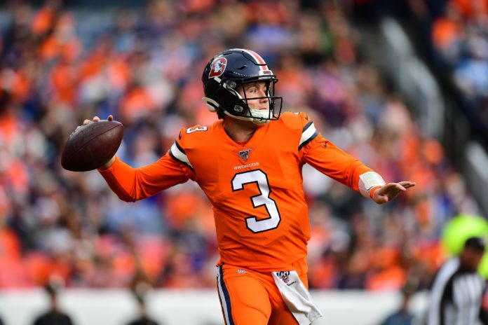 Denver Broncos quarterback Drew Lock (3) prepares to pass the ball in the first quarter against the Detroit Lions at Empower Field at Mile High.