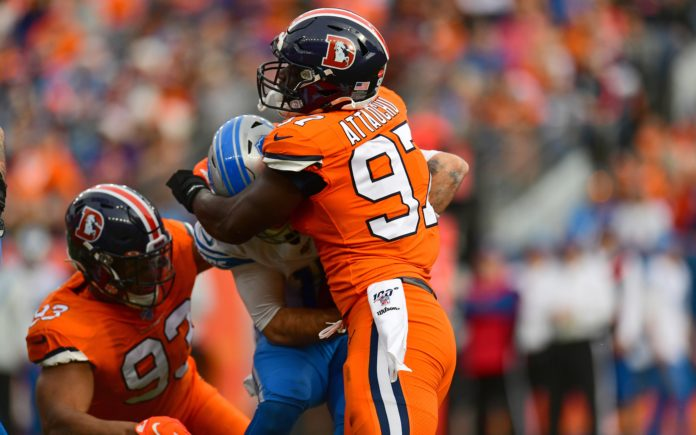 Dre'Mont Jones (93) earns his half a sack against David Blough of the Detroit Lions. Credit: Ron Chenoy, USA TODAY Sports.