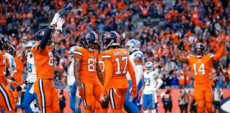 Denver Broncos wide receiver DaeSean Hamilton (17) celebrates with wide receiver Tim Patrick (81) and tight end Noah Fant (87) after scoring a touchdown against the Detroit Lions in the fourth quarter at Empower Field at Mile High.