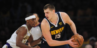 Denver Nuggets center Nikola Jokic (15) controls the ball against Los Angeles Lakers guard Rajon Rondo (9) during the second half at Staples Center.