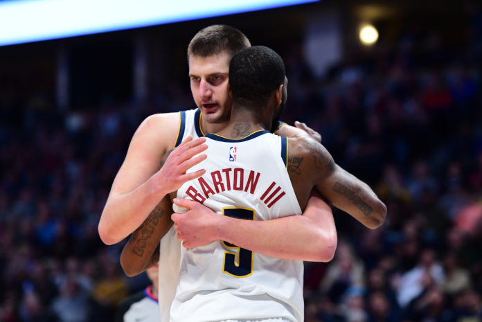 Nuggets center Nikola Jokic (15) and Denver Nuggets guard Will Barton (5) celebrate a score in the second half against the Memphis Grizzlies at the Pepsi Center.