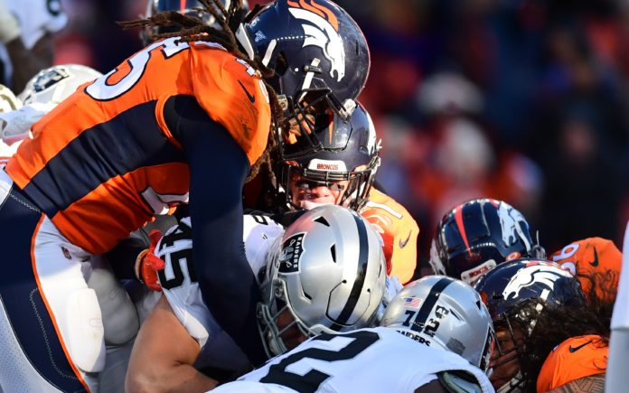 Alexander Johnson and Broncos teammates stop Ingold from scoring, the turning point of Denver's win. Credit: Ron Chenoy, USA TODAY Sports.