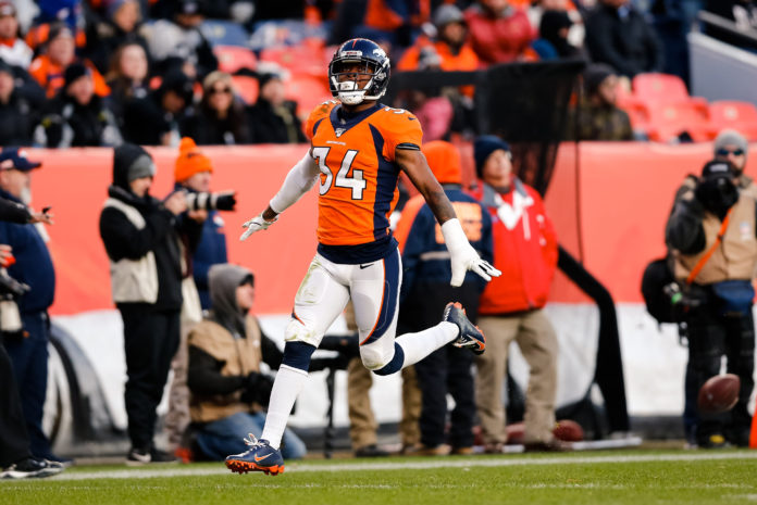 Denver Broncos strong safety Will Parks (34) reacts after a play in the third quarter against the Oakland Raiders at Empower Field at Mile High.