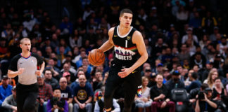 Denver Nuggets forward Michael Porter Jr. (1) dribbles the ball up court in the first quarter against the Sacramento Kings at the Pepsi Center.