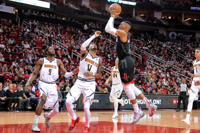 Houston Rockets guard Russell Westbrook (0) takes an inside shot against the Denver Nuggets during the second quarter at Toyota Center.
